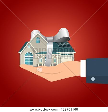 Hand holding residential building with the gray colored ribbon. Vector illustration.