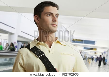 Mixed race man in airport