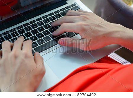 Man Is Typing On Laptop Keyboard