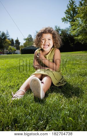 Mixed race girl laughing in park