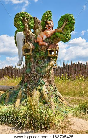 Berendeyevo, Russia, Moscow region, 26 July, 2014, Park of fairy-tale characters, orange cat in the tree