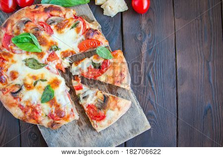 Top View Of Pizza With Tomatoes And Mushrooms Mozarella On A Wooden Board. Raw Vegetables- Cherry To