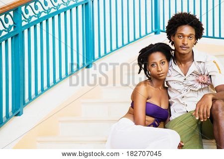 African couple sitting on deck