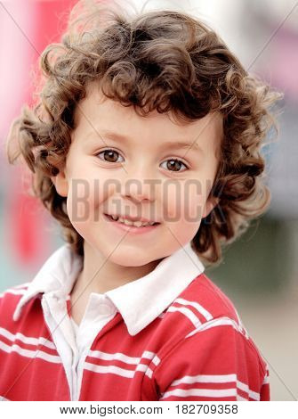 Adorable small child outside looking at camera