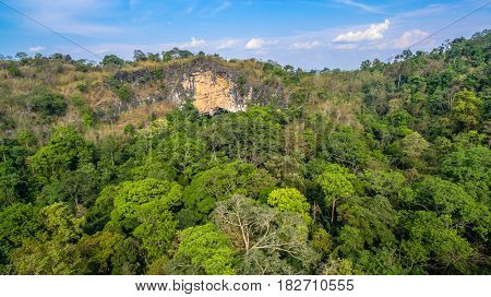 aerial photography above amazing cave. Tham Than Lod Yai is the big cave and have one hole on the top of the cave. it is a short cave there have waterfall pass inside through to another cave