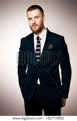 Portrait of a handsome man wearing elegant suit. Male beauty, fashion. Studio shot.