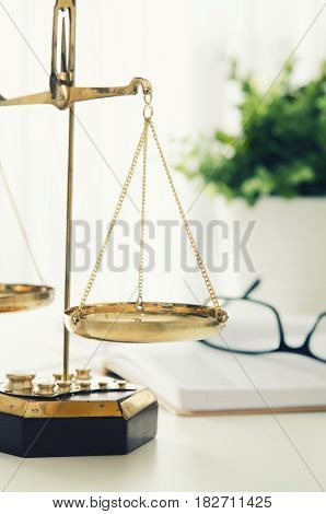 Law scale justice with book and glasses in background. law scale attorney justice legal courtroom lawyer symbol concept