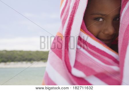 African girl wrapped in beach towel