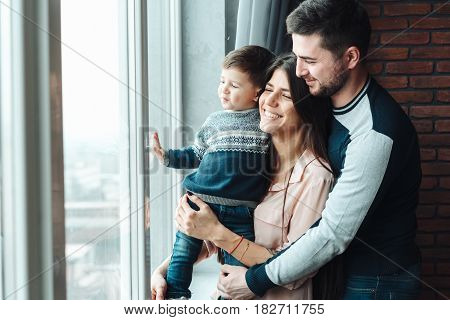Young parents with their sweet baby. Happy family.