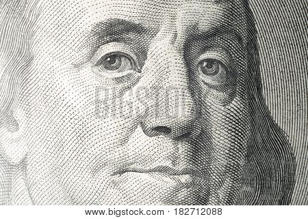 A fragment of the portrait of the banknote of USD 100 large