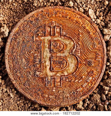 closeup of old and damaged bitcoin on ground