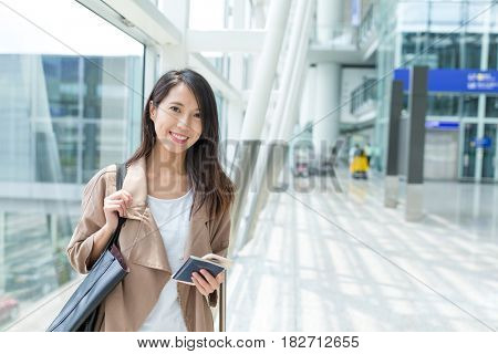 Woman using mobile phone in airport