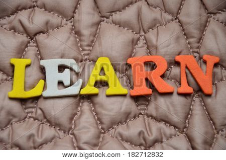 word nlearn on a abstract colorful background
