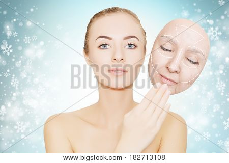 christmas present: woman enjoys her healthy skin without wrinkles