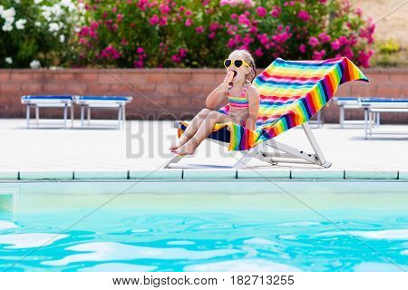 Child Eating Ice Cream At Swimming Pool