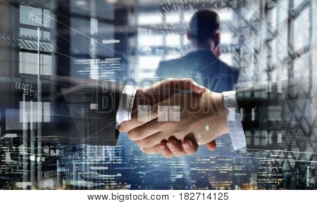 Partners shaking hands as symbol of deal . Mixed media