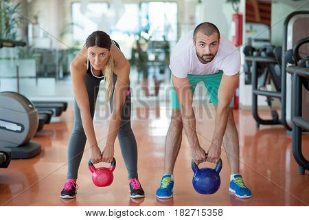 Fit people working out in fitness class at the gym.