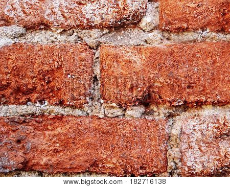 Old destroyed brick wall. Red brickwork corroded by corrosion and time. Grunge background for your concept or project. Horizontal location.