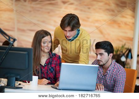 startup business people group working as team to find solution to problem.