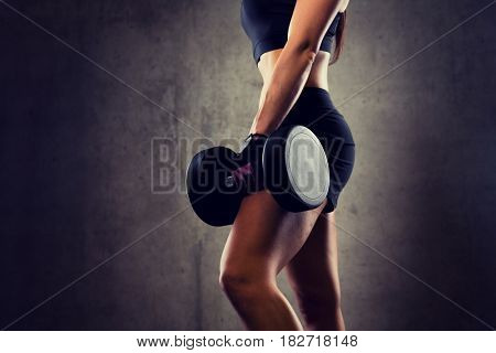 sport, fitness, bodybuilding, weightlifting and people concept - close up of woman with dumbbell in gym