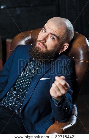 Portrait Of A Bearded Man In A Suit.