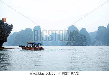 Halong Bay Vietnam - March 7 2017: travel boat near Cat Ba island Halong Bay Vietnam
