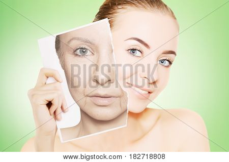 young gorgeous woman breaks photo with her old face