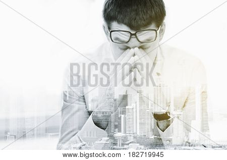 business, people, deadline and stress concept - tired businessman with eyeglasses at office over city buildings and double exposure effect