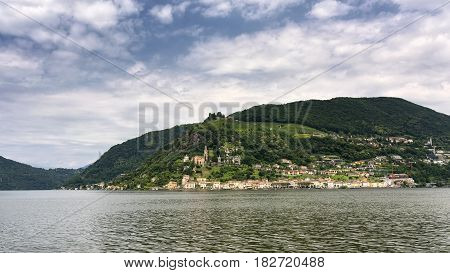 The Ceresio Lake (Ticino Switzerland)) landscape at summer. Church of Santa Maria del Sasso