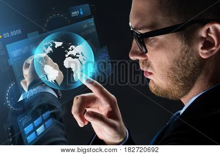 business, people and modern technology concept - close up of businessman with smart watch, virtual screen projection and earth projection over black background