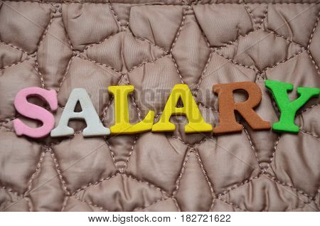 word salary on a  abstract colorful background