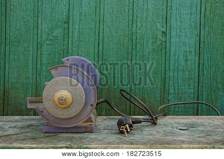 Old machine tool on a wooden bench