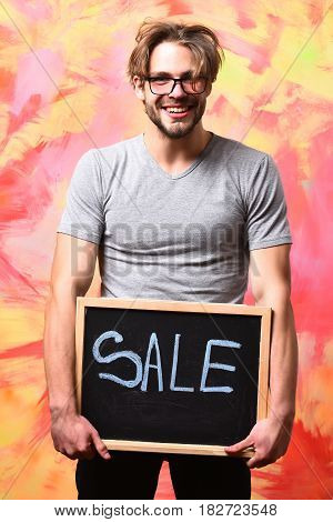 Caucasian Bearded Sexy Macho Man Holding Board With Sale Inscription