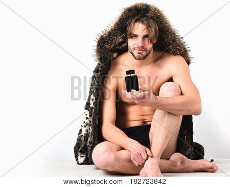Bearded Macho Man In Fur Coat On White Background