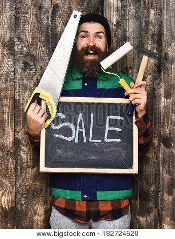 Bearded Man Holding Various Building Tools And Board, Happy Face