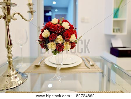 Red Roses Bouquet In The Middle Of Dining Table In Modern Living Room Of Apartment, Interior Design