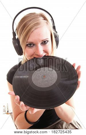 Woman with headphones listening to music - isolated over a white background analogue record