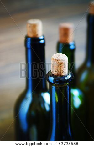 The wine bottles. Shallow depth of field