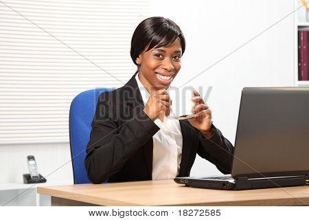 Beautiful Black Woman Drinks Coffee At Work