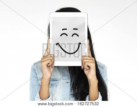 Woman holding digital device covering face photoshooting for photograph