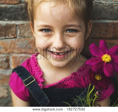 A girl is smiling with flower