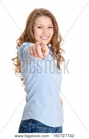 Attractive young woman pointing with finger. All on white background.