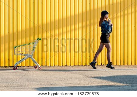 Cheerful Stylish Young Girl In Hat, And Jeans Jacket With Candy On Stick, Chupa Chups, On Sunny Day,