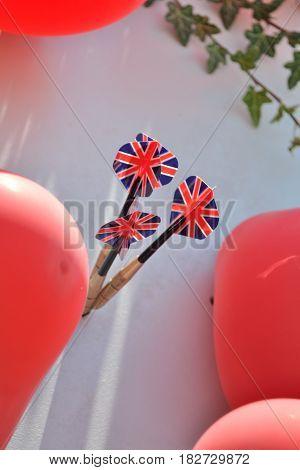 Three darts pinned between balloons - close-up