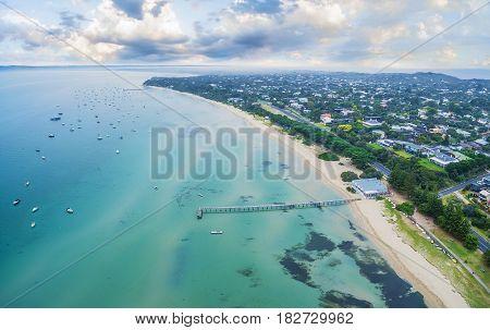 Aerial View Of Beautiful Coastline Of Mornington Peninsula Near Sorrento Suburb Showcasing Long Pier