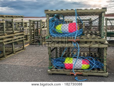 Lobster traps on a wharf along the shores of rural Prince Edward Island, Canada.