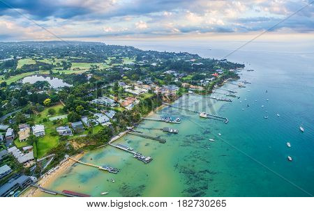 Aerial Landscape Of Sorrento Suburb Coastline With Private Piers And Moored Boats At Sunrise. Mornin