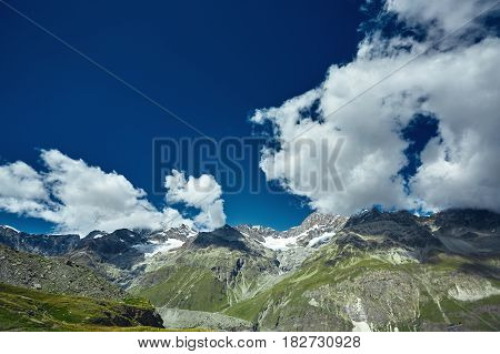 Amazing View of the mountain range near the Matterhorn in the Swiss Alps. Snow capped mountains. Trek near Matterhorn mount.