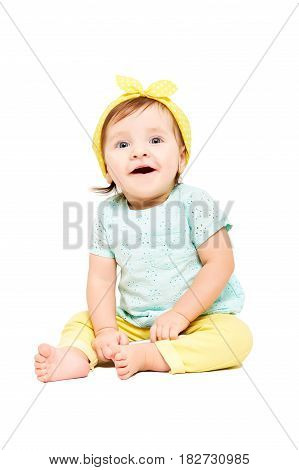 Portrait of a cute smiling baby girl, sitting isolated on white background