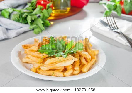 A Serving Plate Of French Fries On The Served Table With Fresh Ingridients. Close- Up. Selective Foc